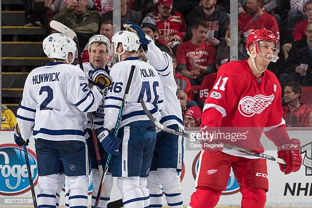 Roman Polak of the Toronto Maple Leafs celebrates his second period goal with teammates Matt Hunwick Nazem Kadri Leo Komarov and William Nylander as...