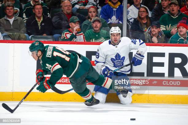 Roman Polak of the Toronto Maple Leafs collides with Joel Eriksson Ek of the Minnesota Wild during the game at the Xcel Energy Center on December 14...