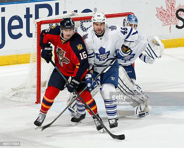 Roman Polak of the Toronto Maple Leafs defends against Aleksander Barkov of the Florida Panthers late in third period action at the BBT Center on...