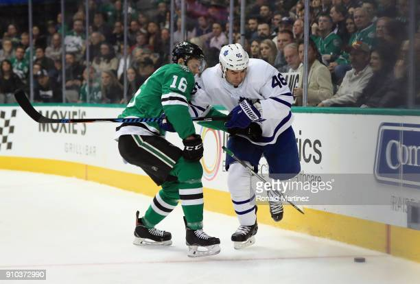 Roman Polak of the Toronto Maple Leafs skates the puck against Jason Dickinson of the Dallas Stars at American Airlines Center on January 25 2018 in...