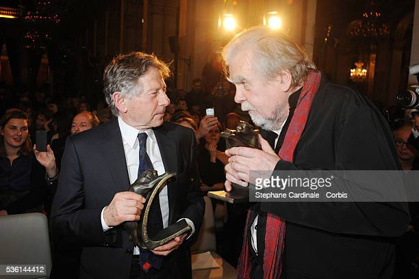 Roman Polanski and Michael Lonsdale pose after being awarded during the 16th Ceremonie Des Lumieres at Paris City Hall