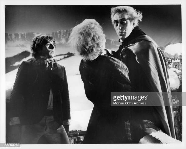 Roman Polanski brushes snow off of Jack MacGowran in a scene from the film 'The Fearless Vampire Killers' 1967