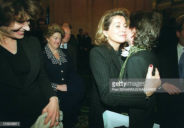 Roman Polanski inducted in the French Academy of fine arts In Paris France On December 15 1999 With Fanny Ardant and Catherine Deneuve