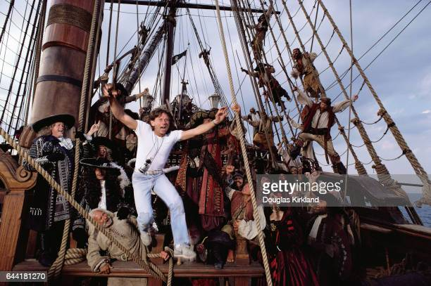 Roman Polanski leaps in to action directing actors on the set of the movie Pirates Actress Charlotte Lewis can be seen by the rope bottom right