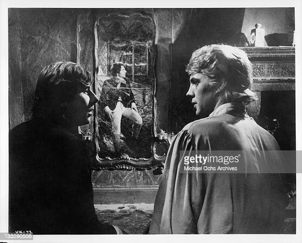 Roman Polanski reacts in horror when he realizes only his reflection can be seen in the mirror which concludes Iain Quarrier is a vampire in a scene...