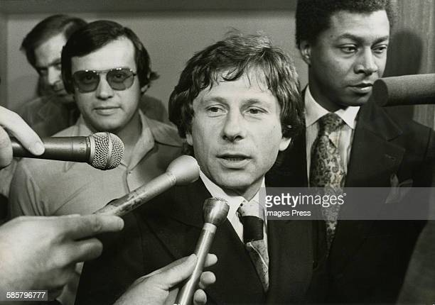 Roman Polanski surrounded by reporters at the Santa Monica Courthouse circa 1977 in Santa Monica California