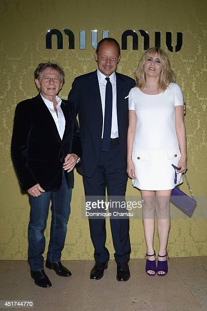 Roman PolanskiStefano Cantino and Emmanuelle Seigner attend the Miu Miu Resort Collection 2015 at Palais d'Iena on July 5 2014 in Paris France