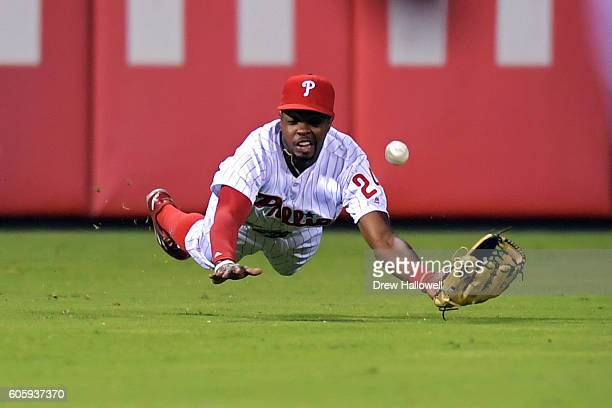 Roman Quinn of the Philadelphia Phillies is unable to catch the ball on the dive in the ninth inning against the Pittsburgh Pirates at Citizens Bank...
