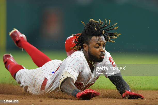 Roman Quinn of the Philadelphia Phillies slides into third base on a triple in the eighth inning against the Washington Nationals at Citizens Bank...