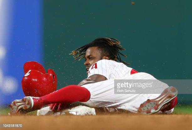 Roman Quinn of the Philadelphia Phillies steals second base against the Atlanta Braves during the second inning of a game at Citizens Bank Park on...