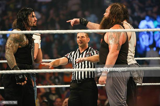 Roman Reigns and Bray Wyatt stare each other down at the WWE SummerSlam 2015 at Barclays Center of Brooklyn on August 23 2015 in New York City