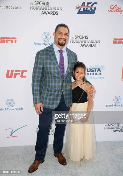 Roman Reigns and daughter attend the 4th Annual Sports Humanitarian Awards at The Novo by Microsoft on July 17 2018 in Los Angeles California
