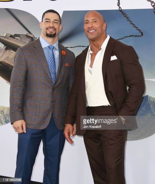 Roman Reigns and Dwayne Johnson attend the Premiere Of Universal Pictures' Fast Furious Presents Hobbs Shaw at Dolby Theatre on July 13 2019 in...