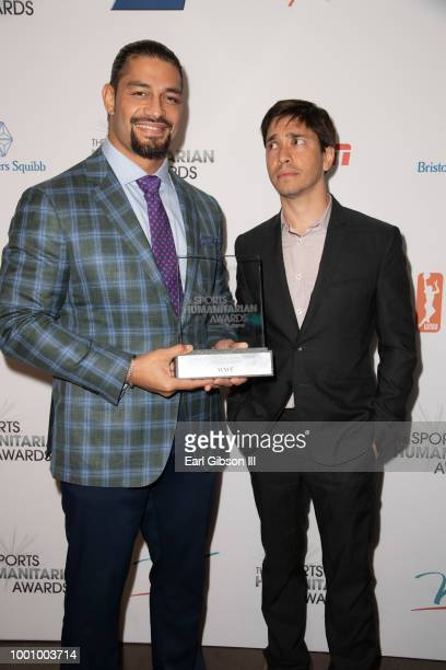 Roman Reigns and Justin Long attend the 4th Annual Sports Humanitarian Awards at The Novo by Microsoft on July 17 2018 in Los Angeles California