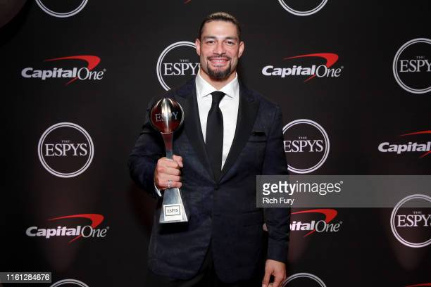 Roman Reigns poses with his ESPY Award for Best WWE Moment during The 2019 ESPYs at Microsoft Theater on July 10 2019 in Los Angeles California