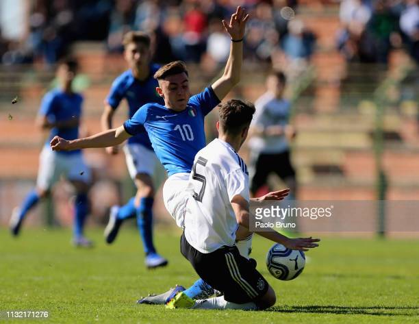 Roman Reinelt of Germany U16 competes for the ball with Federico Zuccon of Italy U16 during the International Friendly match between Italy U16 and...