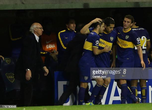 Roman Riquelme, of Boca Juniors celebrates with teammates after scoring during a match between Boca Juniors and Atletico Rafaela as part of the...