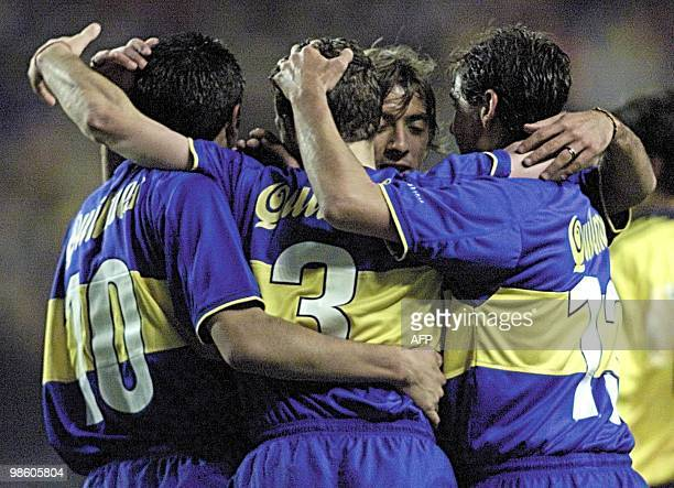 Roman Riquelme Rodolfo Arruabarrena and Cristian Traverso embrace Julio Marchant after he made the third goal for Boca Juniors 31 May 2000 during a...