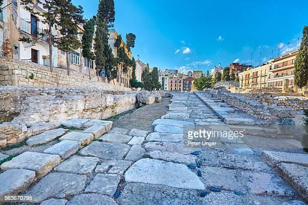 roman ruins of the forum of tarragona, spain - tarragona stock photos and pictures