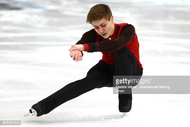 Roman Sadovsky of Canada performs during the Mens Short program on Day 1 of the ISU Grand Prix of Figure Skating at Herb Brooks Arena on November 24...