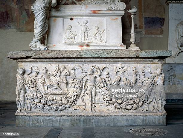 Roman sarcophagus decorated in relief with a festoon held by female figures on either side and in the center by a male figure and two principle...