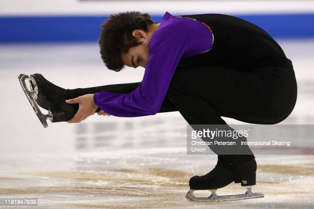 Roman Savosin of Russia performs during men's short program in the ISU Grand Prix of Figure Skating Skate America at the Orleans Arena on October 18,...