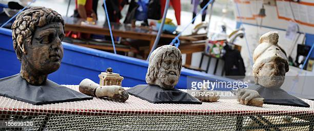Roman sculptures and fragments a Neptune or Jupiter head and a fullscale marble head of the Roman god Mars sit on October 6 2009 at a press...