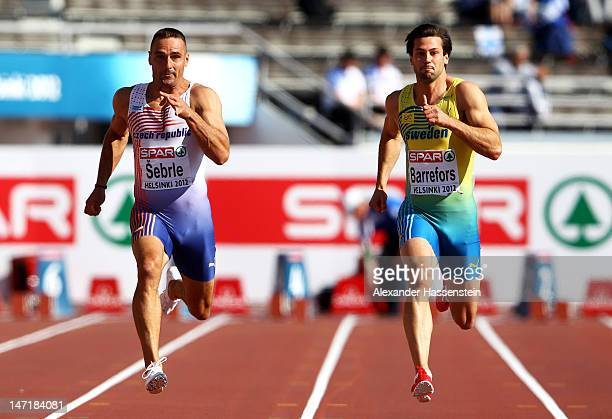 Roman Sebrle of Czech Republic and Bjorn Barrefors of Sweden compete in the 100 Metres during the Men's Decathlon during day one of the 21st European...