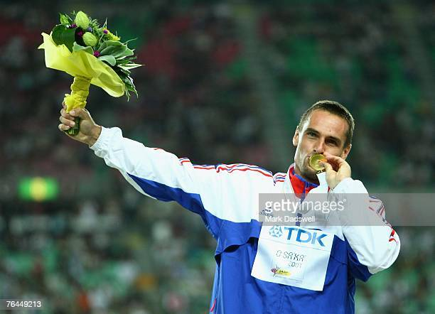 Roman Sebrle of the Czech Republic celebrates his gold medal victory following the 1500m event of the Men's Decathlon during day eight of the 11th...