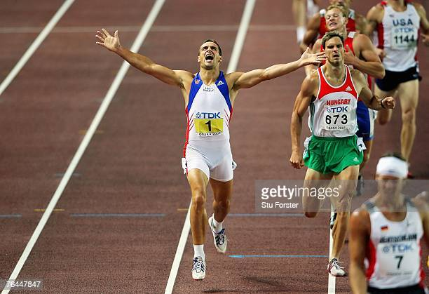 Roman Sebrle of the Czech Republic celebrates overall victory as he crosses the finish line in the 1500m event of the Men's Decathlon during day...