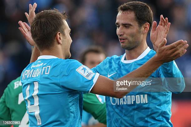 Roman Shirokov of FC Zenit St. Petersburg celebrates after scoring a goal with Domenico Criscito during the Russian Premier League match between FC...