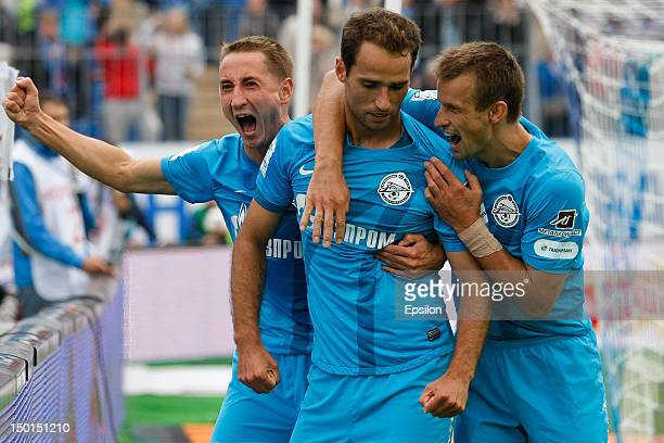 Roman Shirokov of FC Zenit St. Petersburg celebrates his goal with Vladimir Bystrov and Sergei Semak of FC Zenit St. Petersburg, during the Russian...