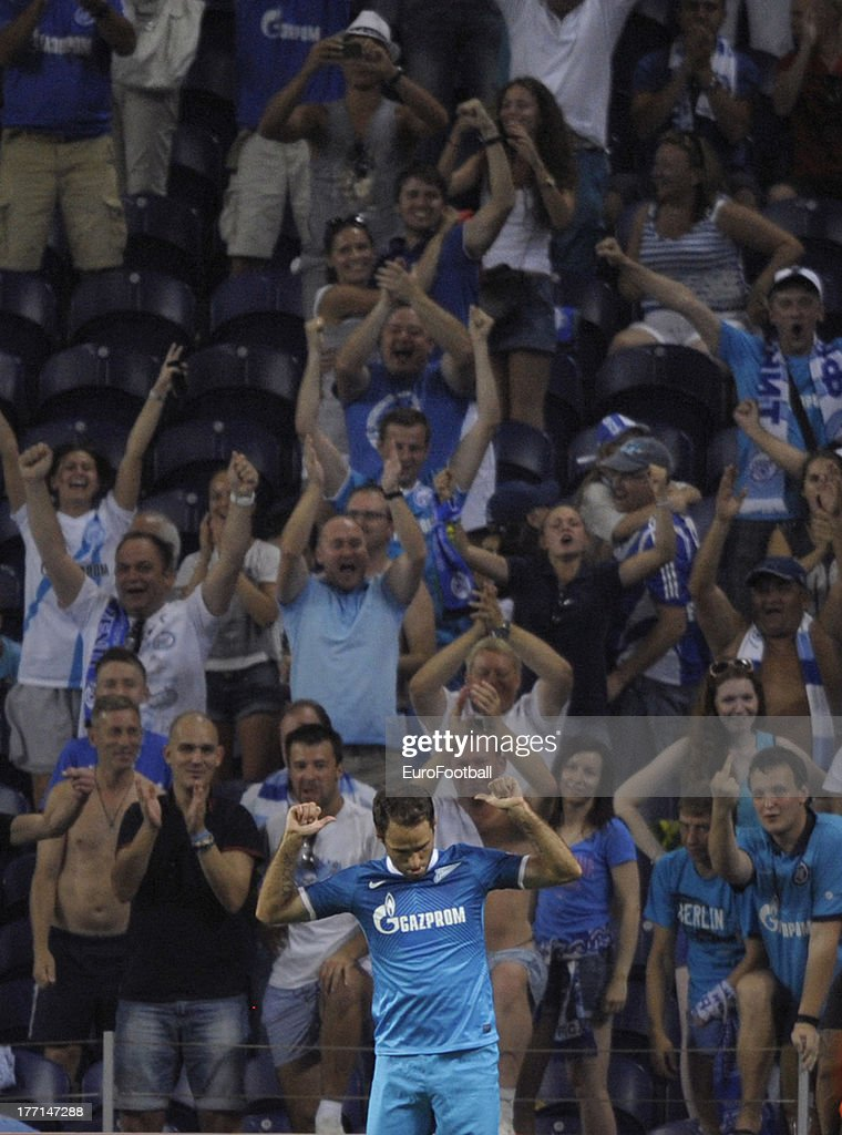 Roman Shirokov of FC Zenit St Petersburg celebrates scoring a goal during the UEFA Champions League play-off first leg match between FC Pacos de Ferreira and FC Zenit St Petersburg held on August 20, 2013 at the Estadio do Dragao, in Porto, Portugal.