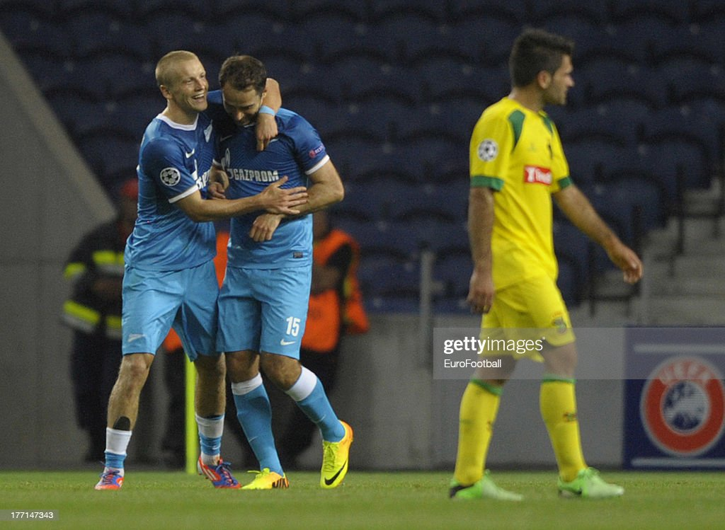 Roman Shirokov (R) of FC Zenit St Petersburg celebrates scoring a goal with team-mate Igor Smolnikov during the UEFA Champions League play-off first leg match between FC Pacos de Ferreira and FC Zenit St Petersburg held on August 20, 2013 at the Estadio do Dragao, in Porto, Portugal.