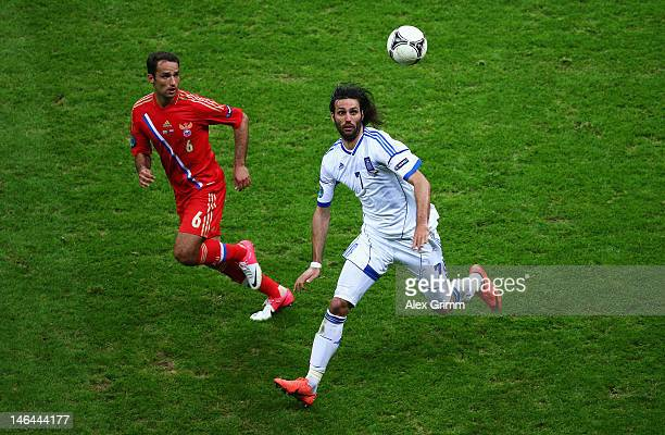 Roman Shirokov of Russia and Giorgos Samaras of Greece look to control the ball during the UEFA EURO 2012 group A match between Greece and Russia at...