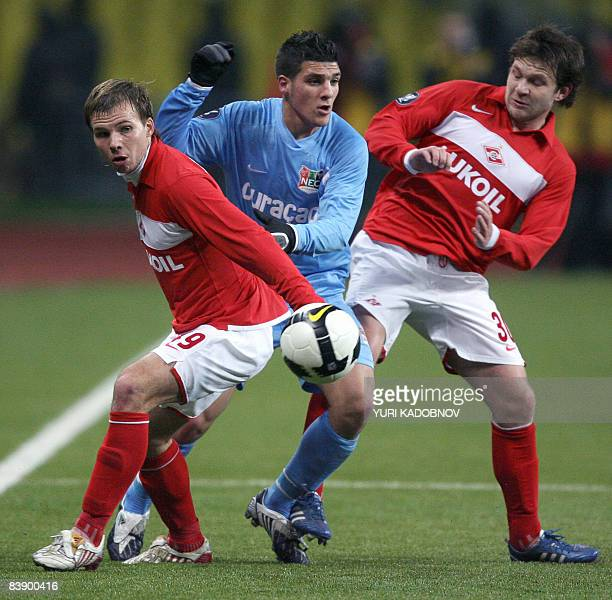Roman Shishkin and Ivan Saenko of Spartak Moscow vie with Mostapha El Kabir of Dutch NEC Nijmegen during their UEFA Cup group D football match in...
