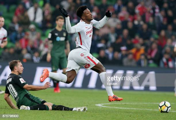 Roman Shishkin of FC Krasnodar vies for the ball with Luiz Adriano of FC Spartak Moscow during the Russian Premier League match between FC Krasnodar...