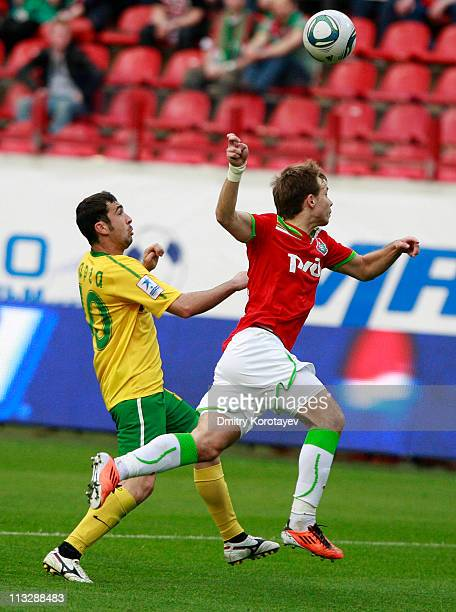 Roman Shishkin of FC Lokomotiv Moscow battles for the ball with Dacian Varga of FC Kuban Krasnodar during the Russian Football League Championship...