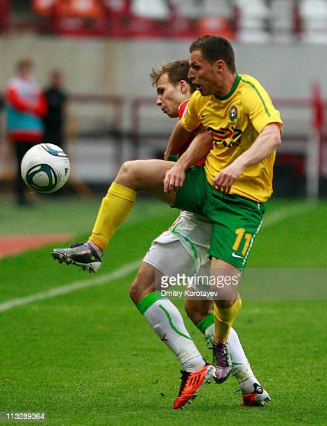 Roman Shishkin of FC Lokomotiv Moscow battles for the ball with Gheorghe Bucur of FC Kuban Krasnodar during the Russian Football League Championship...