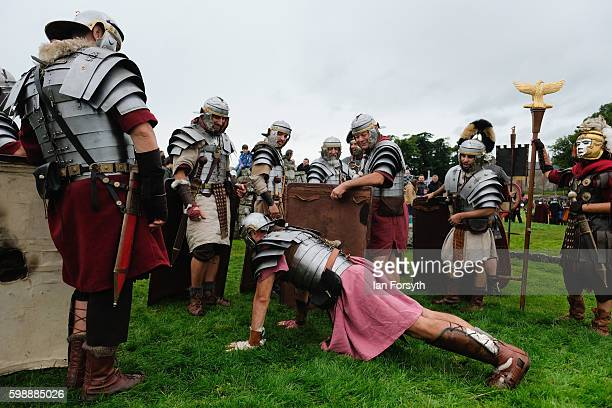 Roman soldier carries out pressups in full armour ahead of a battle as the lives of Roman Legionnaires are reenacted during the Hadrian's Wall Live...
