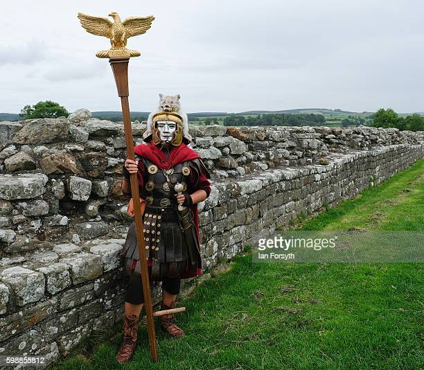 Roman soldier carrying the Eagle standard stands next to Hadrian's Wall as the lives of Roman Legionnaires are reenacted during the Hadrian's Wall...