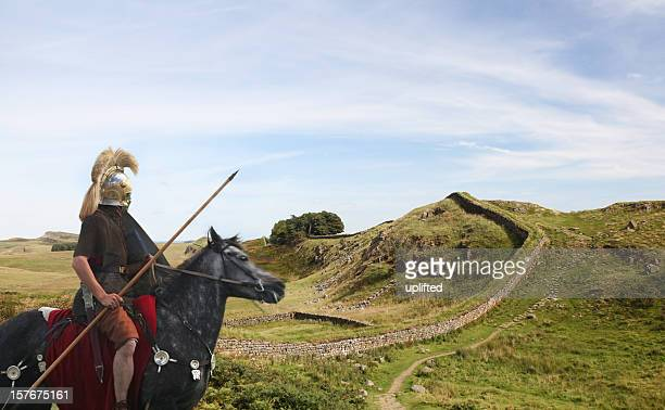 roman soldier guarding hadrians wall - british culture stock pictures, royalty-free photos & images