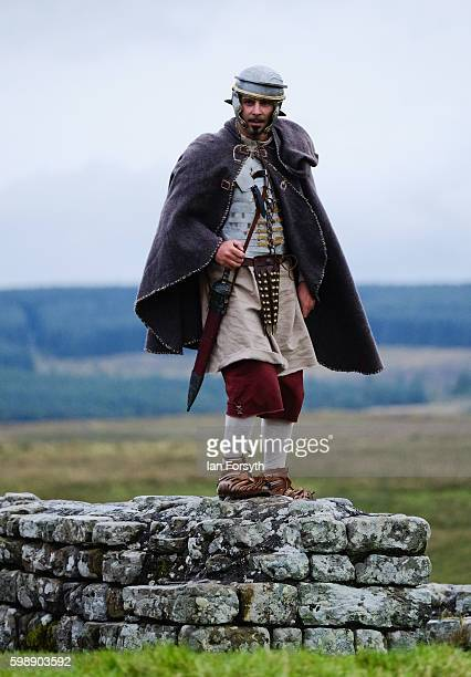 Roman soldier poses on Hdrian's Wall as the lives of Roman Legionnaires are reenacted during the Hadrian's Wall Live event at Housesteads Roman fort...