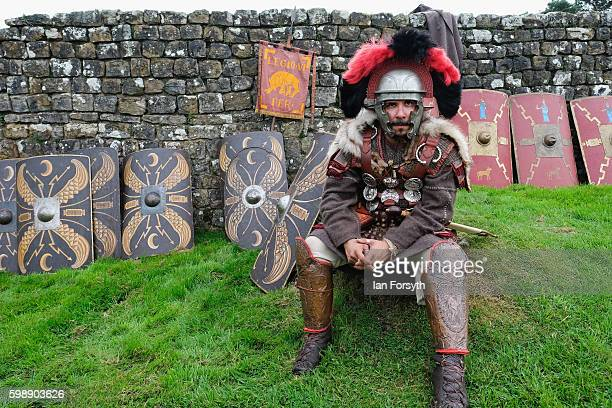 Roman soldier rests on grass next to Hadrian's Wall as the lives of Roman Legionnaires are reenacted during the Hadrian's Wall Live event at...