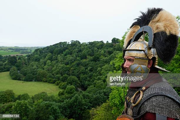 Roman soldier stands guard looking out over the countryside of Cumbria from the Birdoswald Roman Fort as the lives of Roman Legionnaires are...