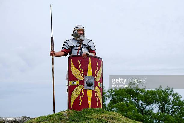 Roman soldier stands on guard as the lives of Roman Legionnaires are reenacted during the Hadrian's Wall Live event at Birdoswald Roman fort on...