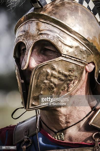 Roman soldier wearing a Corinthian helmet 450400 BC Historical reenactment