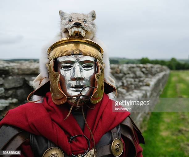 Roman soldier wears a mask as the lives of Roman Legionnaires are reenacted during the Hadrian's Wall Live event at Birdoswald Roman fort on...
