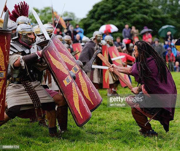 Roman soldiers battle with Barbarian warriors as the lives of Roman Legionnaires are reenacted during the Hadrian's Wall Live event at Birdoswald...