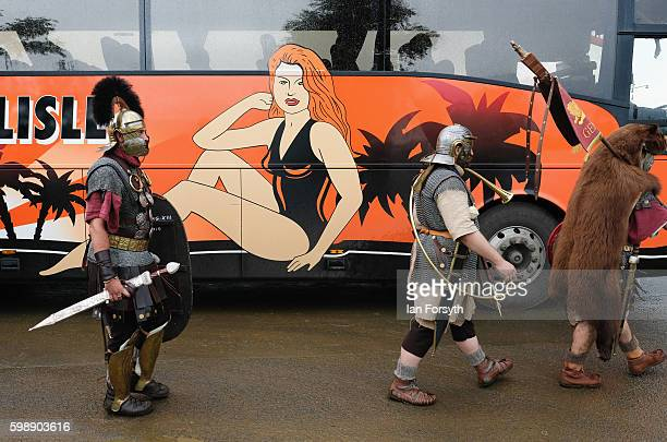 Roman soldiers catch a bus as the lives of Roman Legionnaires are reenacted during the Hadrian's Wall Live event at Housesteads Roman fort on...
